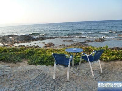 Table and chairs of a Taverna diret on the sea on Crete