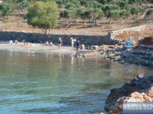 Tourists on a beach in Crete.